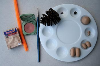 萌萌哒小刺猬 将纸粘土如下图做出刺猬的四肢和头部,用工具压出脚趾.