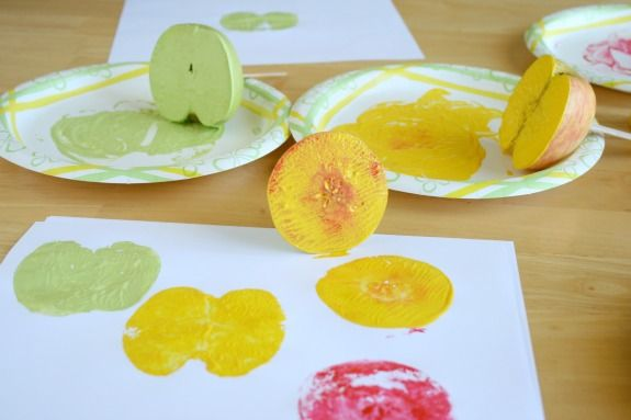 Stamping-Apples-in-Paint-for-a-fun-Apple-Print